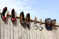 Four pairs of ladies shoes elegant aired on the fence Stock Images