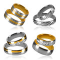 Four pairs of rings isolated golden and silver wedding decorated with diamonds Stock Images