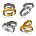 Four pairs of rings isolated golden and silver wedding decorated with diamonds Stock Photography