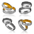 Four pairs of rings isolated golden and silver wedding decorated with diamonds Stock Photos