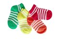 Four pairs of striped baby socks on white background Stock Images