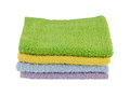 Four pastel wash cloths in colors on white background Stock Image