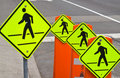 Four pedestrian traffic warning signs Stock Photography