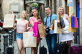Four people holding paper bags Royalty Free Stock Photo