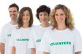 Four people wearing volunteer tshirt on white background Royalty Free Stock Photography