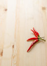 Four pieces of chili on wooden background Royalty Free Stock Photo