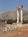 Four pillars of stone in a lebanese ruins site from the roman era Royalty Free Stock Images