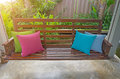 Four pillow  Placed on a wooden swing in the resort. Royalty Free Stock Photo