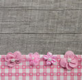 Four pink handmade flowers on wooden grey shabby chic background Royalty Free Stock Photo