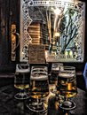 Four pints of beer in front of pub window in London Royalty Free Stock Photo