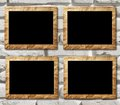 Four placards of black in decorative scopes on a brick background Royalty Free Stock Photo
