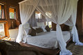 Four-poster bed in an African lodge Royalty Free Stock Photo