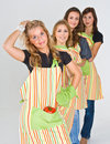 Four pretty teenage cooks Royalty Free Stock Photo