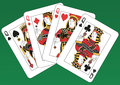 Four queens fours playing cards on a green background Stock Images