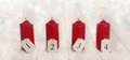 Four red burning advent candles on snowy white wooden background Royalty Free Stock Photo