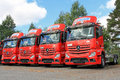 Four red mercedes benz actros trucks lieto finland august row of in lieto finland on august starts second half of with Royalty Free Stock Images