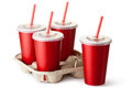 Four red takeout cups with a cup holder Royalty Free Stock Photo