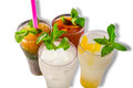 Four refreshing ice beverages top view iced tea lemonade coconut juice and tapioca with gelatin drinks Stock Photos