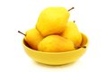 Four ripe pears in the yellow bowl. Royalty Free Stock Photos