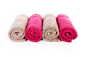 Four rolled colorful towels Royalty Free Stock Photo