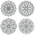 Four round ornaments - spring flower. Mandala set for coloring book. Abstract vector lace designs.