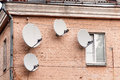 Four satellite dishes Royalty Free Stock Photo