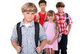 Four schoolchildren with backpacks on their way to school Royalty Free Stock Images