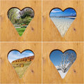 Four season collage door with heart shaped holes with scenes Stock Images