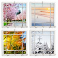 Four season views throgh grungy painted windows Stock Photo