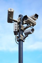 Four security cameras on blue sky a Stock Photography