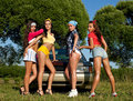 Four sexy pin-up woman near car with graffiti Royalty Free Stock Photo
