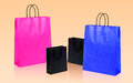Four shopping bags on orange Royalty Free Stock Photos