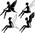 Four silhouettes of fairies with different wings Stock Photos