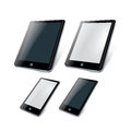 Four smart phones and tablets on white background Stock Photography