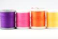 Four spools of thread on white Royalty Free Stock Photo