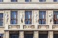 Four statues of habits old greek on an art nouveau building in prague czech republic Stock Photo