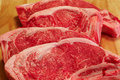Four strip steaks Royalty Free Stock Image