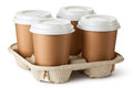 Four take-out coffee in holder Royalty Free Stock Image