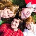 Four teenager lay on grass Stock Photo