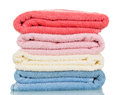 Four of terry towels different colors isolated on white. Royalty Free Stock Photo