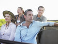 Four tourists sitting in jeep group of on safari Stock Photography