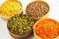Four varieties of lentils in wooden bowls Royalty Free Stock Photo