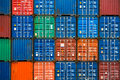 Four vertical rows of shipping containers that are different colors in the port zeebrugge belgium Royalty Free Stock Images