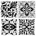 Four vintage foliate ornament designs symmetrical in square format with floral elements isolated on white Stock Photos