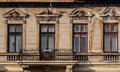 Four vintage windows and a balcony of an old building Stock Image