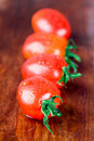 Four wet tomatoes Royalty Free Stock Image