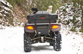 Four Wheeler and Dogs in Snow Royalty Free Stock Photo