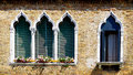Four windows in arch shape and ancient decay brick wall Royalty Free Stock Photo