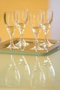 Four wine glasses with white wine on a glass Royalty Free Stock Photos
