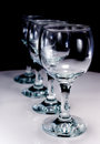 Four wineglass on white table and black background Royalty Free Stock Photo